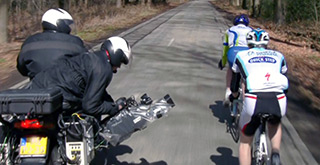 Camera operators following Amstel Gold bicycles riders on motorcycle.